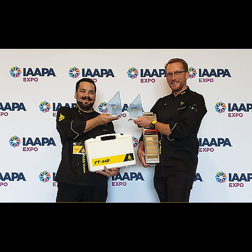 Sascha Geib, COO & Corporate Chef VITO Fryfilter (on the left) and Andreas Schmidt, CEO VITO AG (on the right), receive the IAAPA Brass Ring Awards